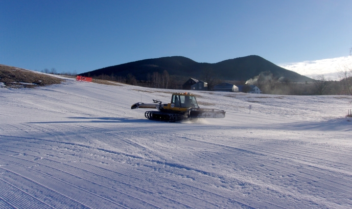 black mountain new hampshire groomer with double top mountain in the background